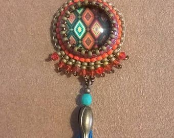 Vintage pendant embroidered Japanese beads on a Blue Suede