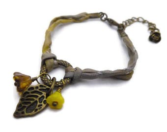 Charms and hand dyed silk cord bracelet