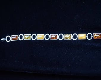 Silver bracelet with 3 different Baltic amber colors, Cognac, Honey, Green
