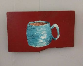 Coffee cup on found board