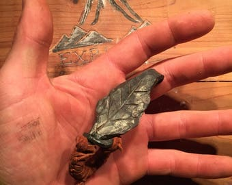 Hand forged leaf bottle opener with leather wrap
