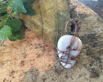 Pebble and copper design pendant.