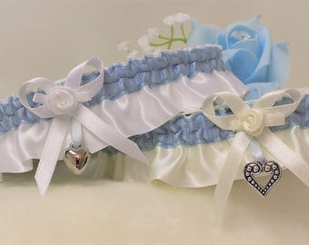 Wedding garter/Bridal Garter. Ivory or white Satin with blue trim. Bow, fabric rose and silver heart charm.