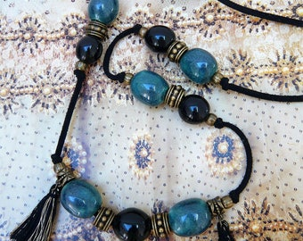 Long necklace with black and gray-green ceramic beads