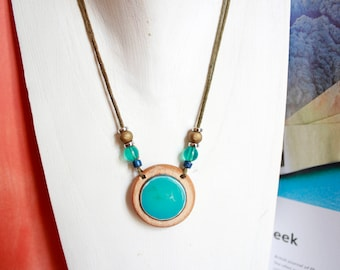 Necklace made of wood and platform turquoise ring