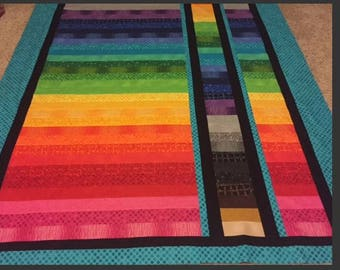Rainbow bright modern quilt for adult child or teen.