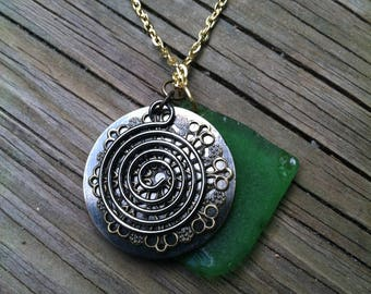 Gold colored chain with a Lg. Green Seaglass and Lg. Bronze spiral charm Necklace