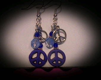 Peace sign funky earrings. Blue magnesite charm w/blue accent beads.