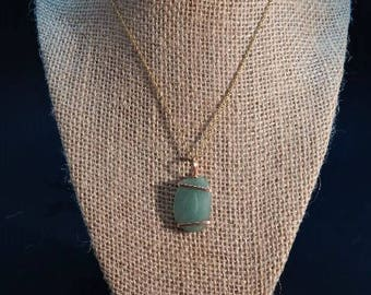 jade and copper pendant