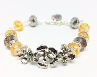 Metallic floral bracelet and amber