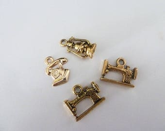 set of 4 charms in gold tone, sewing, phone and Lantern
