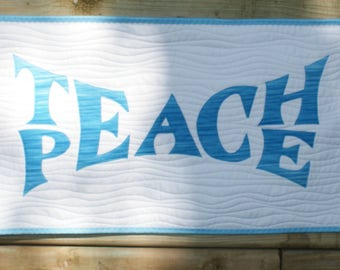 "Teach Peace quilted wallhanging in blue 10"" x 20"""