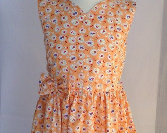 Summer dress for an 8 year old, young lady. Handmade dress in a soft cotton printed with fresh summer colours.
