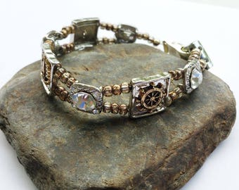 Nautical beaded bracelet with silver and gold tones and 4 large clear crystals with 4 small clear crystals