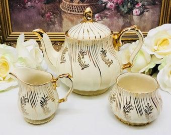 Sadler teapot with cream and sugar.