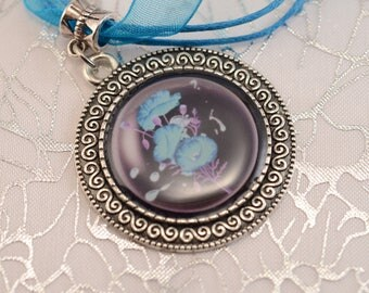 Clearance: Turquoise blue necklace with black and blue flower cabochon