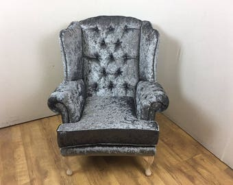 Wing Back Chair with deep buttoned arms - natural wood legs
