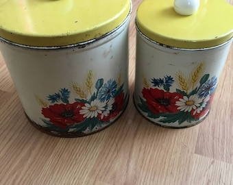 set of 2 tin canisters flowers with yellow lid