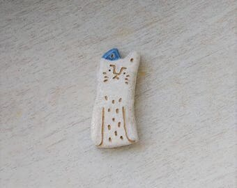 CAT and clay brooch