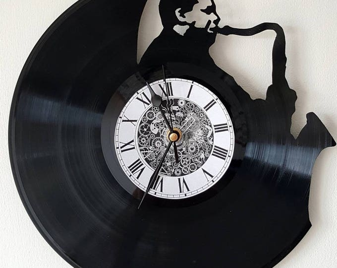 Vinyl 33 clock towers theme sax player
