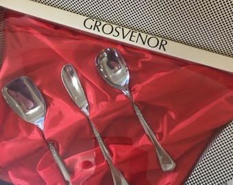 Boxed set containing butter knife, jam and sugar spoons. Grosvenor Australia
