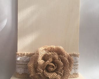 Table number with brown burlap bow in the middle