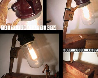 An old globe held by a wheel by lampesoriginales .com key adjustable wrench lamp