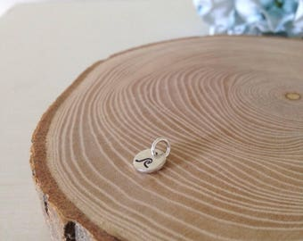 Add a small sterling silver hand stamped disc