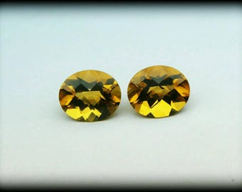 Citrine - AAA Quality Natural citrine oval faceted checker board 12x10 MM. One pair.