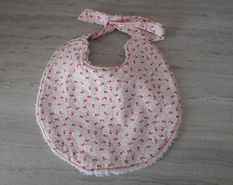 New bib born cotton small red flowers on white background and white cotton towel