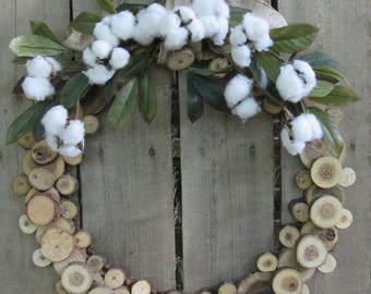 Cotton and wood slice wreath.