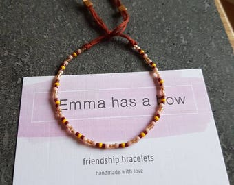 Petite stretchable friendship bracelet in rust with pink yellow and gold