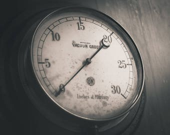Black and white photograph of an industrial vacuum gauge
