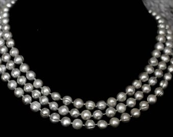 One Strand Of Beautiful 8 mm Round silver Fresh Water Pearl Necklace.