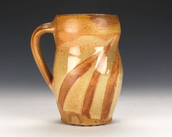 Wood Fired Stoneware mug with wiped Shino Glaze