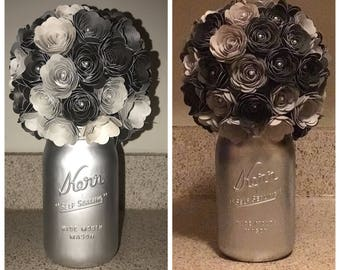 Hand rolled flowers with pearls attached and spray painted mason jar