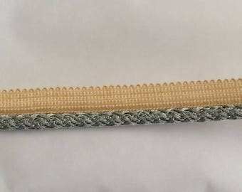 A silver grey piping trim sewing