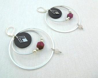 Inner tube and silver hoop earrings