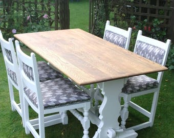Ercol style Oak table plus four superb old chairs with stylish grey fabric.