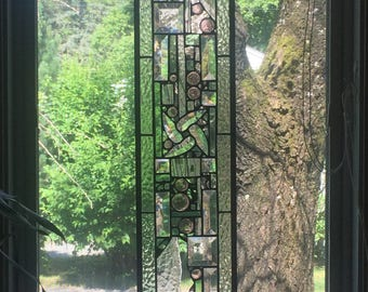 Stained glass panel with antique watches glass