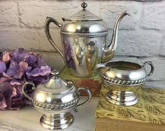 F b Rogers Art Deco Tea Set Teapot Creamer and Sugar Silver over Copper Braid detail VGC