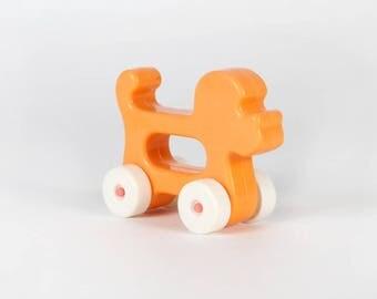 Vintage baby toy-Orange dog on wheels and handle