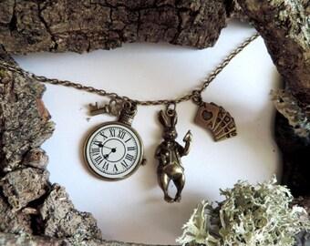 """The world of Alice"" bronze necklace: 3D rabbit, card game, pendulum, key"
