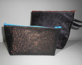 The two sequined black makeup kits