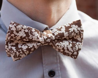Handmade Bow Tie made with handprinted fabric with a story.
