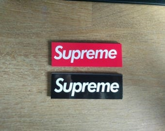 12 small Supreme stickers red/black/mixed