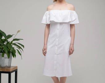 White linen sundress.Bare shoulders flounce dress straight