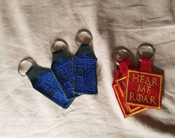 Pronouns, TARDIS & Lannister Words clearance keychains doctor who game of thrones keyfob