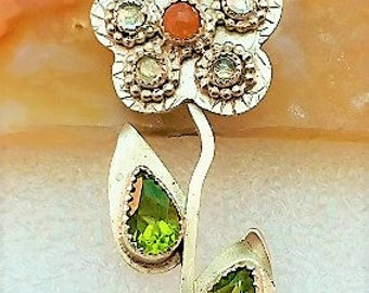 Floral, hand crafted multi gemstone sterling silver pendant with faceted peridots, rose cut peach moonstone and white topaz cabochons