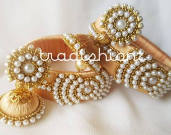 Golden Pearl Embellished Silk Thread Bangles with Jhumkas